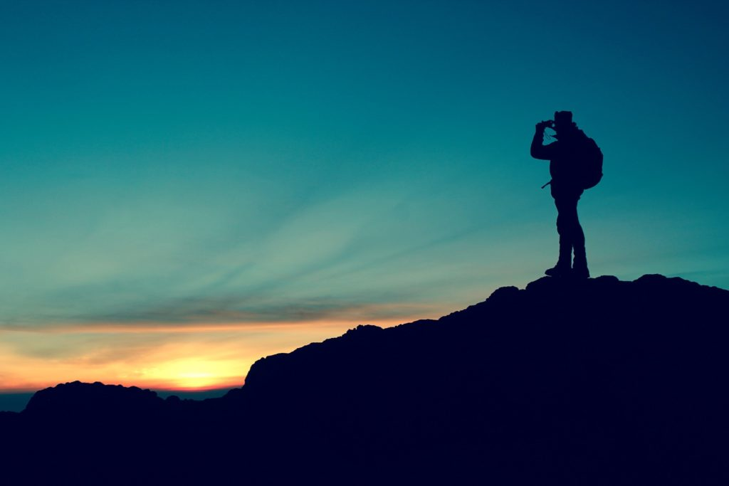 hiker taking a photo from a mountain